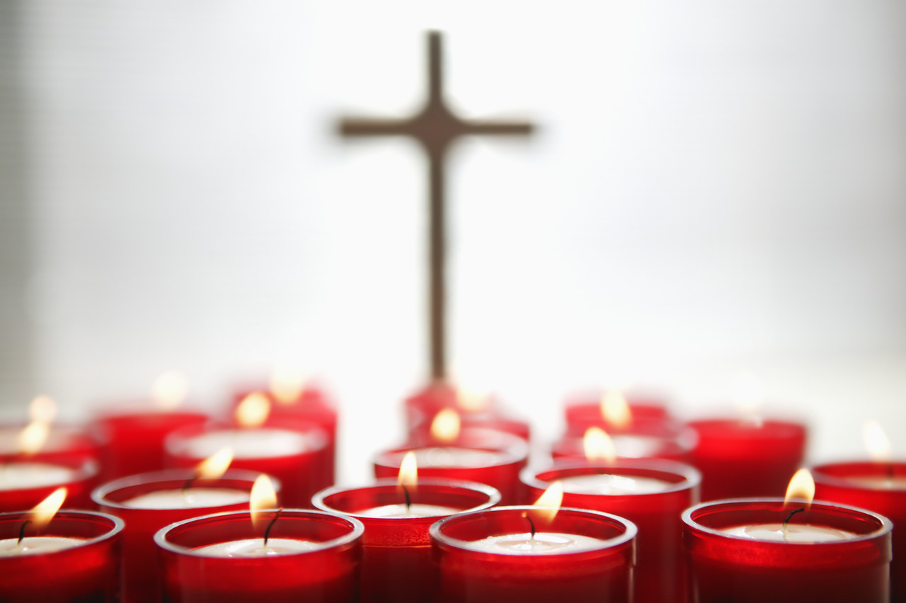 Religious Candles and Cross --- Image by © Royalty-Free/Corbis